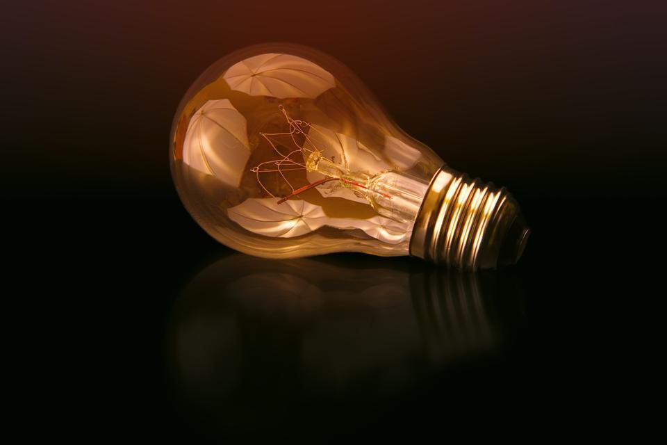 incandescent bulb on black surface